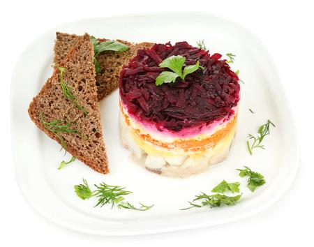 ensaladilla rusa: Russian herring salad on plate isolated on white