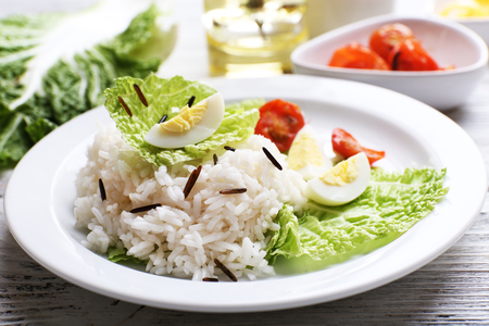 Boiled rice served on table, close-up Stock Photo