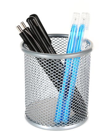 Black and blue pens in grey metal vase isolated on white background
