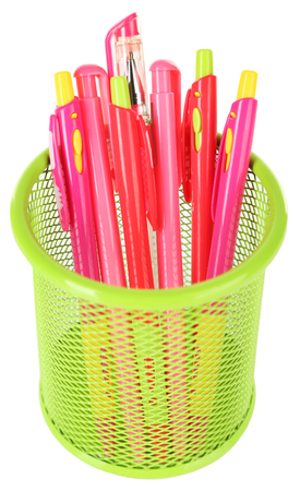 Pink pens in green metal vase isolated on white background Stock Photo