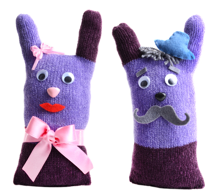 Cute handmade toys of gloves isolated on white