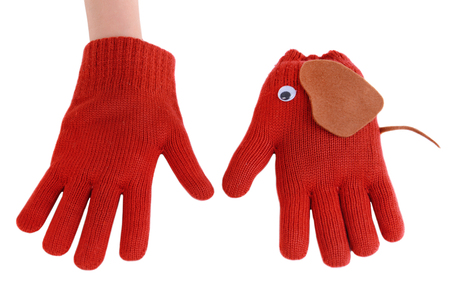Making of handmade toys from gloves isolated on white