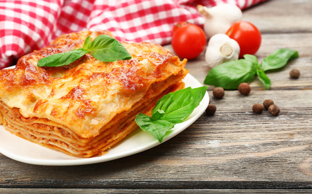 Portion of tasty lasagna on wooden table Banque d'images