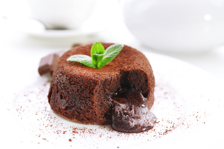 Hot chocolate pudding with fondant centre on plate, close-up Stock Photo