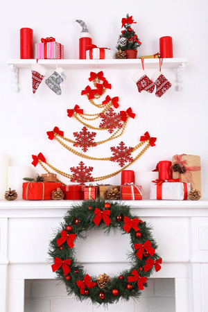 christmas decorations on mantelpiece on white wall background stock photo 98718822 - Mantelpiece Christmas Decorations