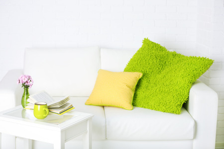 Apartment interior in white color with bright decorative elements 스톡 콘텐츠