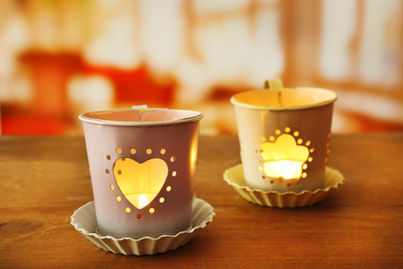 Tow lanterns on wooden surface and blurred background