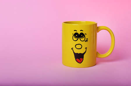 Emotional cup on pink background