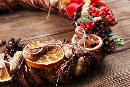 Christmas wreath on rustic wooden background Stock Photo
