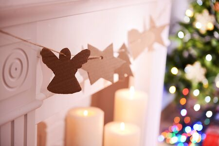 Christmas garland near fireplace close-up Stock Photo
