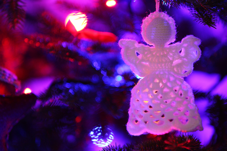 knitted christmas angel on christmas lights background stock photo 99575319
