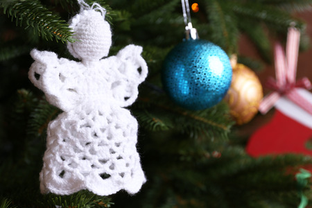 knitted christmas angels and other decorations on christmas tree stock photo picture and royalty free image image 99221998
