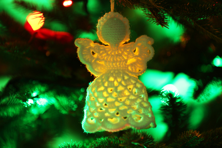 knitted christmas angel on christmas lights background stock photo 99654262