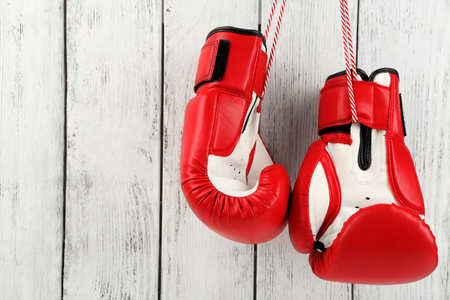 Pair of boxing gloves on color wooden background Stock Photo