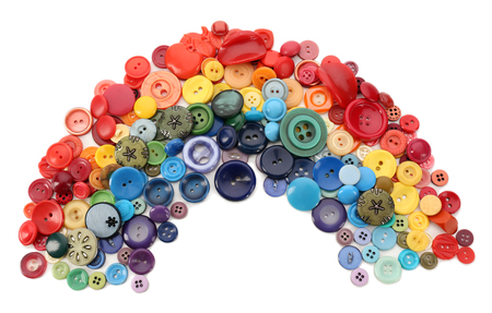 Rainbow of sewing buttons isolated on white