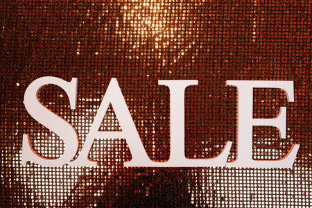 Sale on shiny background