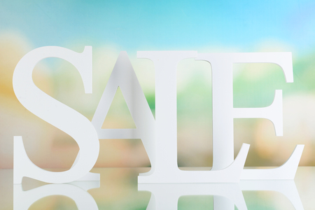 Sale on bright background Stock Photo
