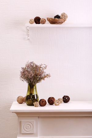 Still life of dried flowers on white wall background