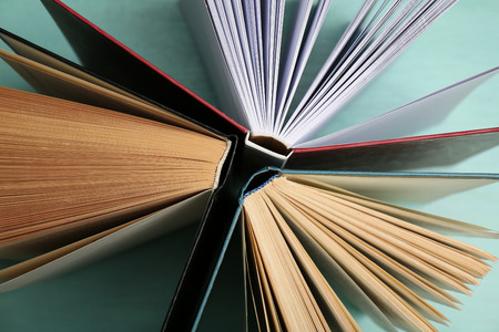 Group of books on colorful background, top view Stock Photo