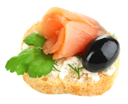 Canape salmon, black olive and herbs  on bread slice isolated on white Stock Photo