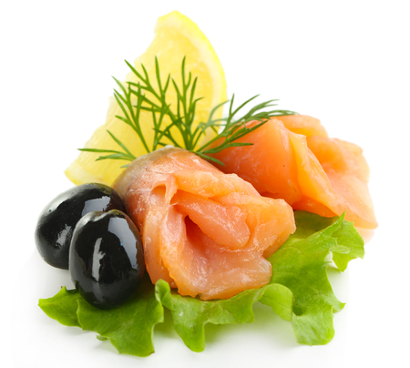Sliced and rolled salmon, black olive and herbs isolated on white Stock Photo