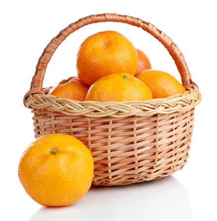 Tangerines in basket isolated on white Stock Photo