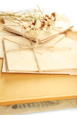 Old letters with dry flowers and book close up