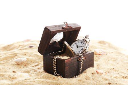 Silver pocket clock on sand isolated on white Reklamní fotografie