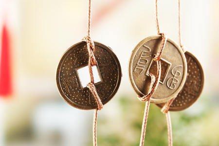 Feng shui coins on light background Stock Photo