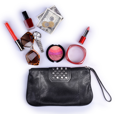 Ladies handbag and things with accessories of it isolated on white Stock Photo