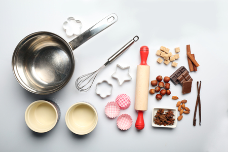 Food ingredients and kitchen utensils for cooking isolated on white