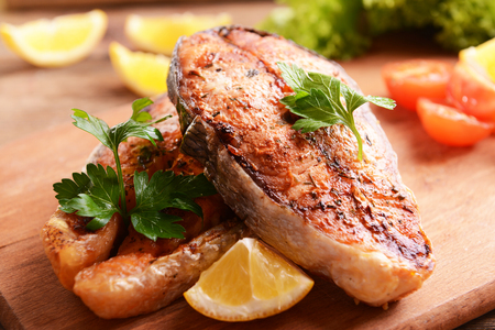 Tasty baked fish on table close-up Foto de archivo