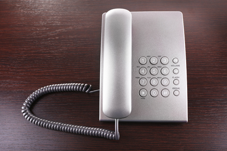 Telephone set on wooden background