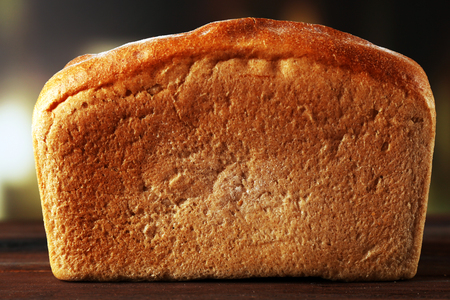 Fresh bread on table on bright background