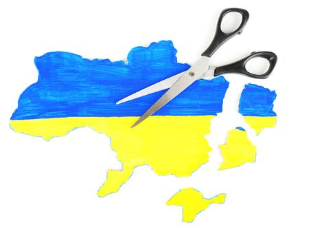 Map of Ukraine and scissors, isolated on white- concept of disintegration of the country Stock Photo