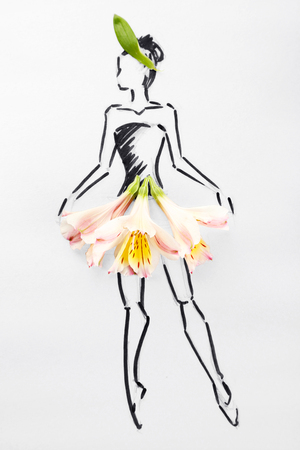 Picture with flower petals and pencils on wooden table Stock Photo