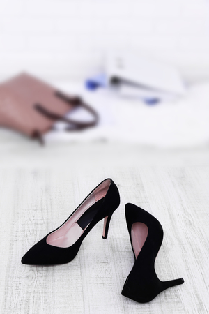 Female shoes and briefcase on floor background 写真素材
