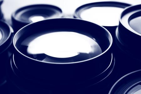 Set of modern camera lenses in shades of grey, closeup