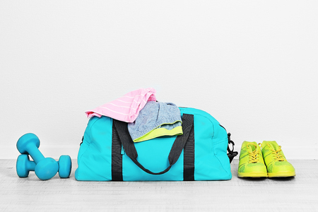Sports bag with sports equipment in room Stockfoto