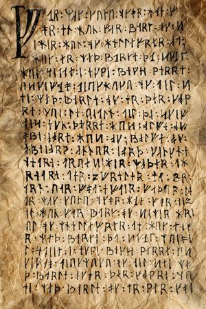 Grunge paper with hieroglyphics close up Фото со стока