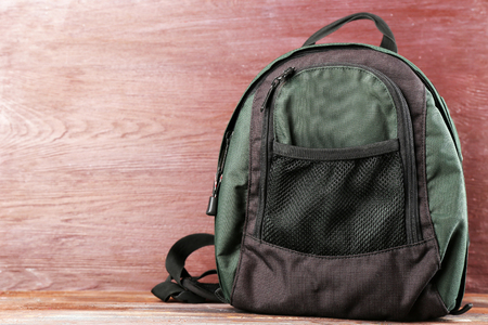 Backpack on wooden background 写真素材
