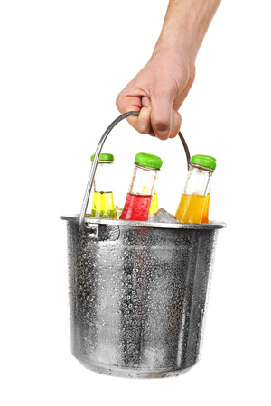 Female hand with metal bucket of alcoholic cocktails isolated on white