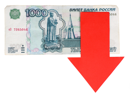 Red arrow on Russian money as depreciation of currency isolated on white Stock Photo