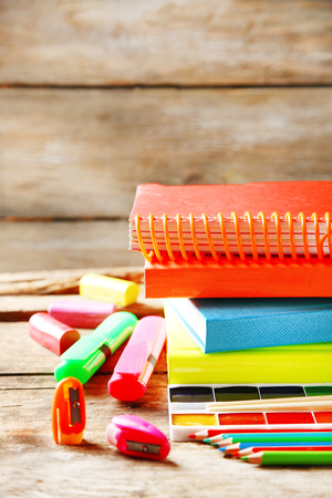 Bright school stationery on old wooden table Stok Fotoğraf