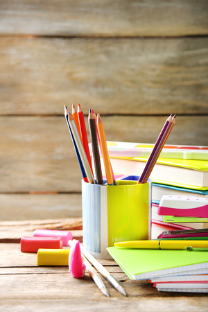 Bright school stationery on old wooden table Banque d'images