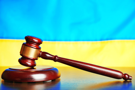 Wooden gavel and flag of Ukraine as background Stock Photo
