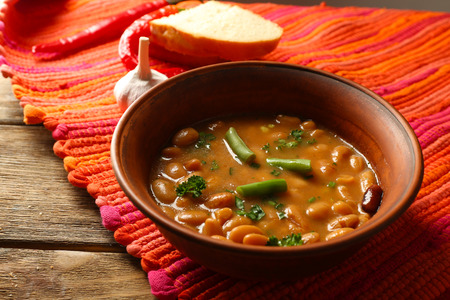 Bean soup in bowl on wooden table background Archivio Fotografico
