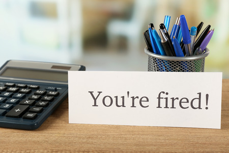 Message You're Fired on wooden table, on blurred background 스톡 콘텐츠 - 100634735