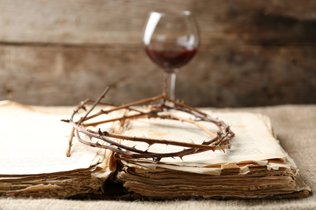 Crown of thorns and bible on old wooden background Stock Photo