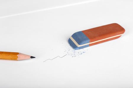 Eraser and pencil on paper background Reklamní fotografie